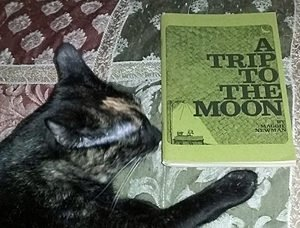 cat with children's book Trip to the Moon