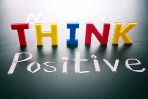 Think positive, do not negative, colorful words on blackboard