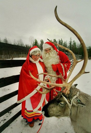 A picture of Santa and Mrs. Claus with reindeer in Finland--Lapland