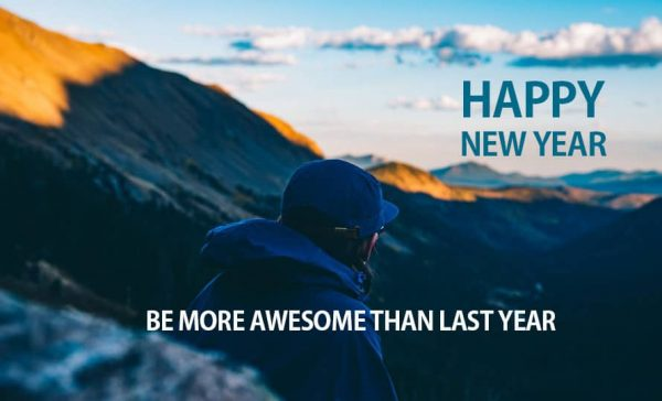 Person sitting on top mountain looking at sunrise. Text is Happy New Year. Be more awesome than last year.