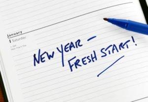 "written on paper ""New Year - fresh start"
