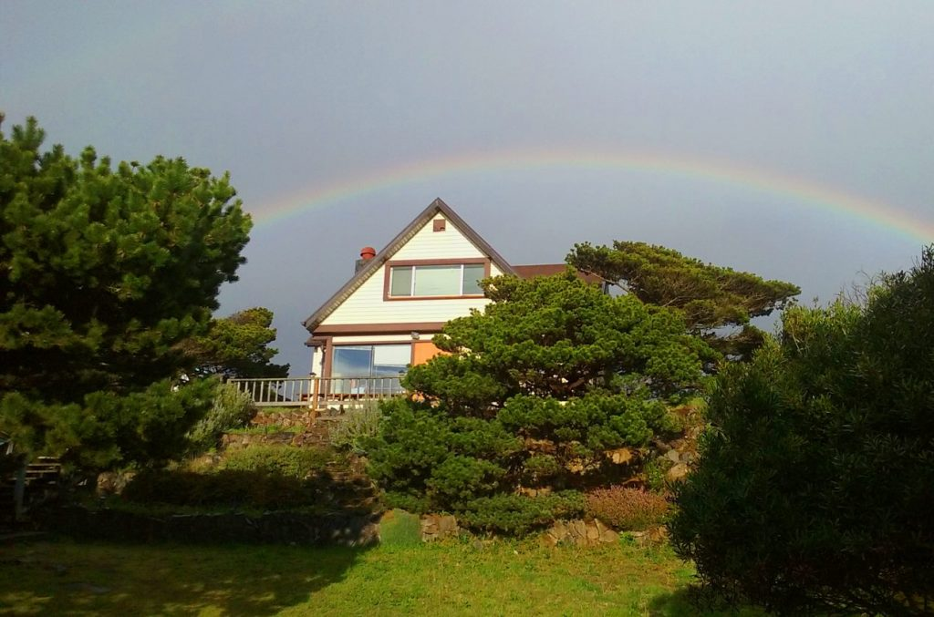 Oregon Writer's Colony house with rainbow. View from West side.