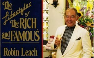 Picture of Robin Leach sipping champagne and the name of his show Lifestyles of the Rich and Famous