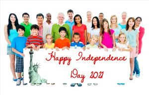 Children and adults together holding a Happy Independence Day 2021 sign